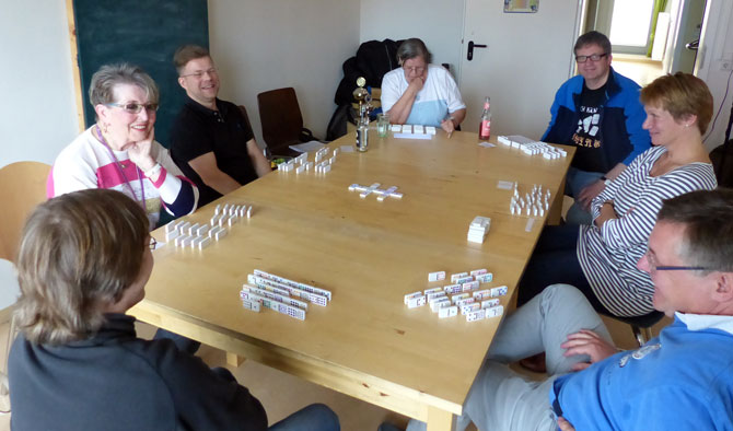 Domino players at table